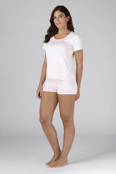 Model wearing the SHEEX Women's Cutout Tee in Blush Pink #choose-your-color_blush-pink