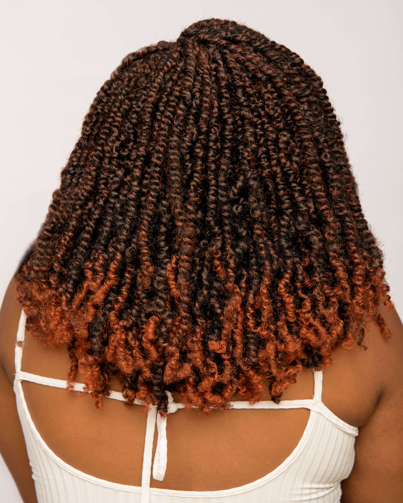 Back view of model in Spring Twists - Natural Girl Wigs