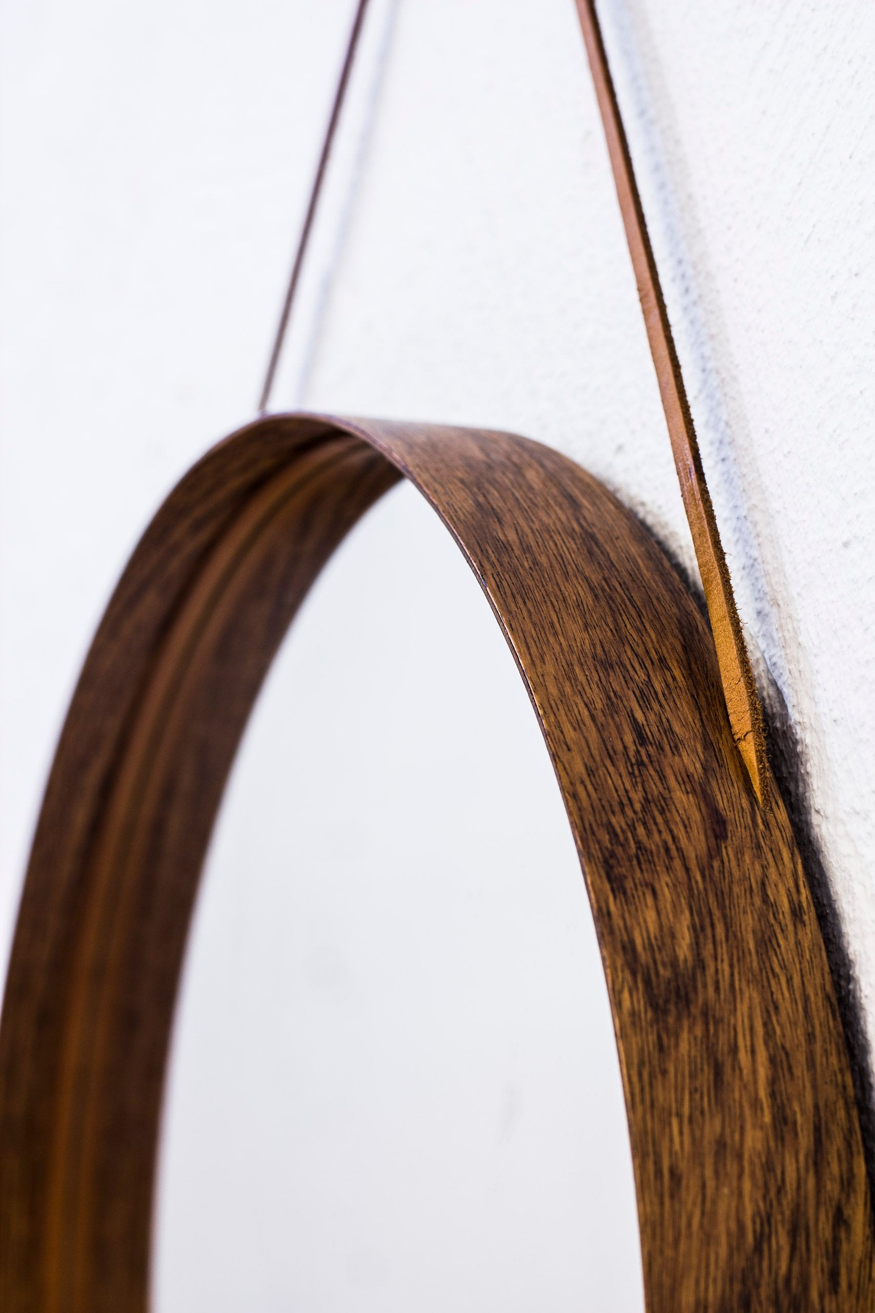 Round wall mirror in rosewood by Glasmäster