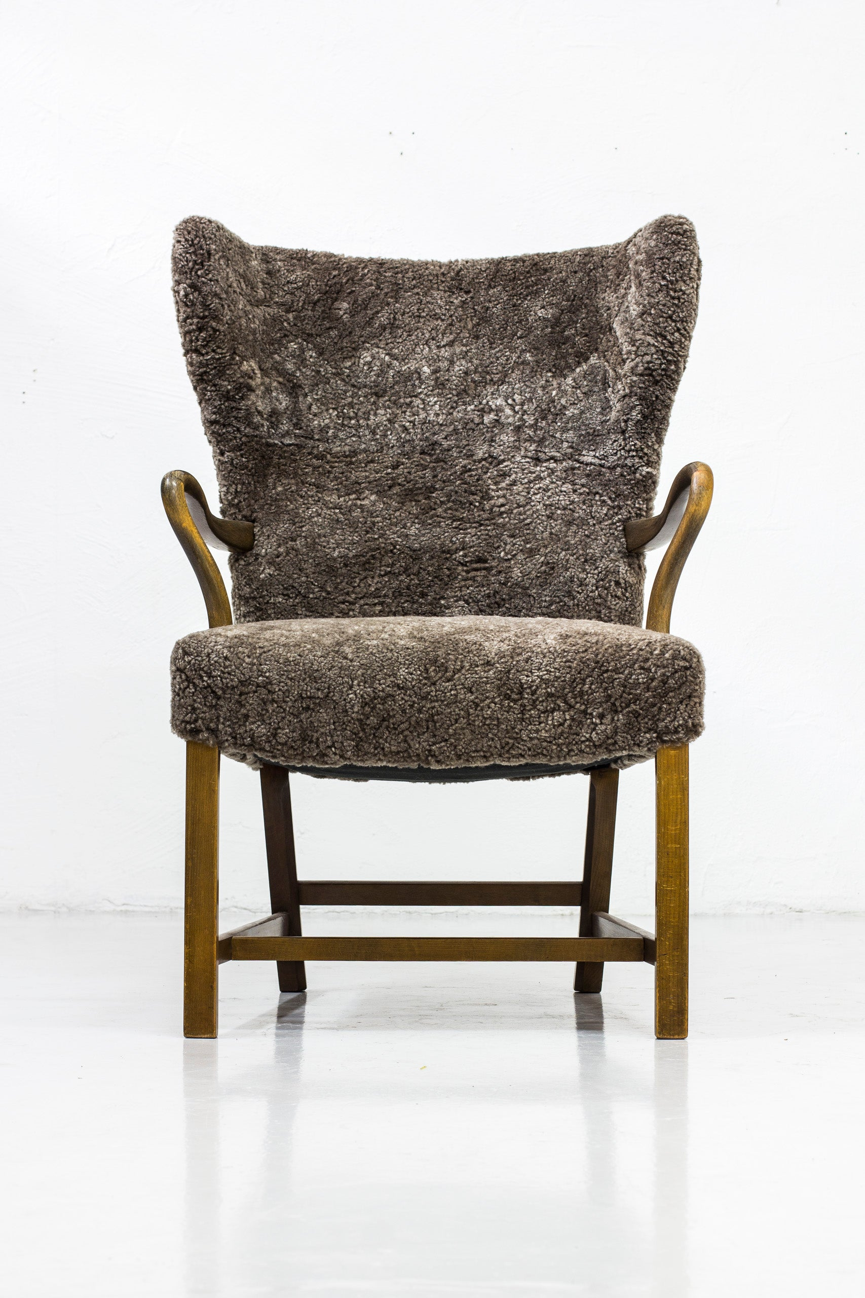 Wingback lounge chair in the manner of Frits Henningsen