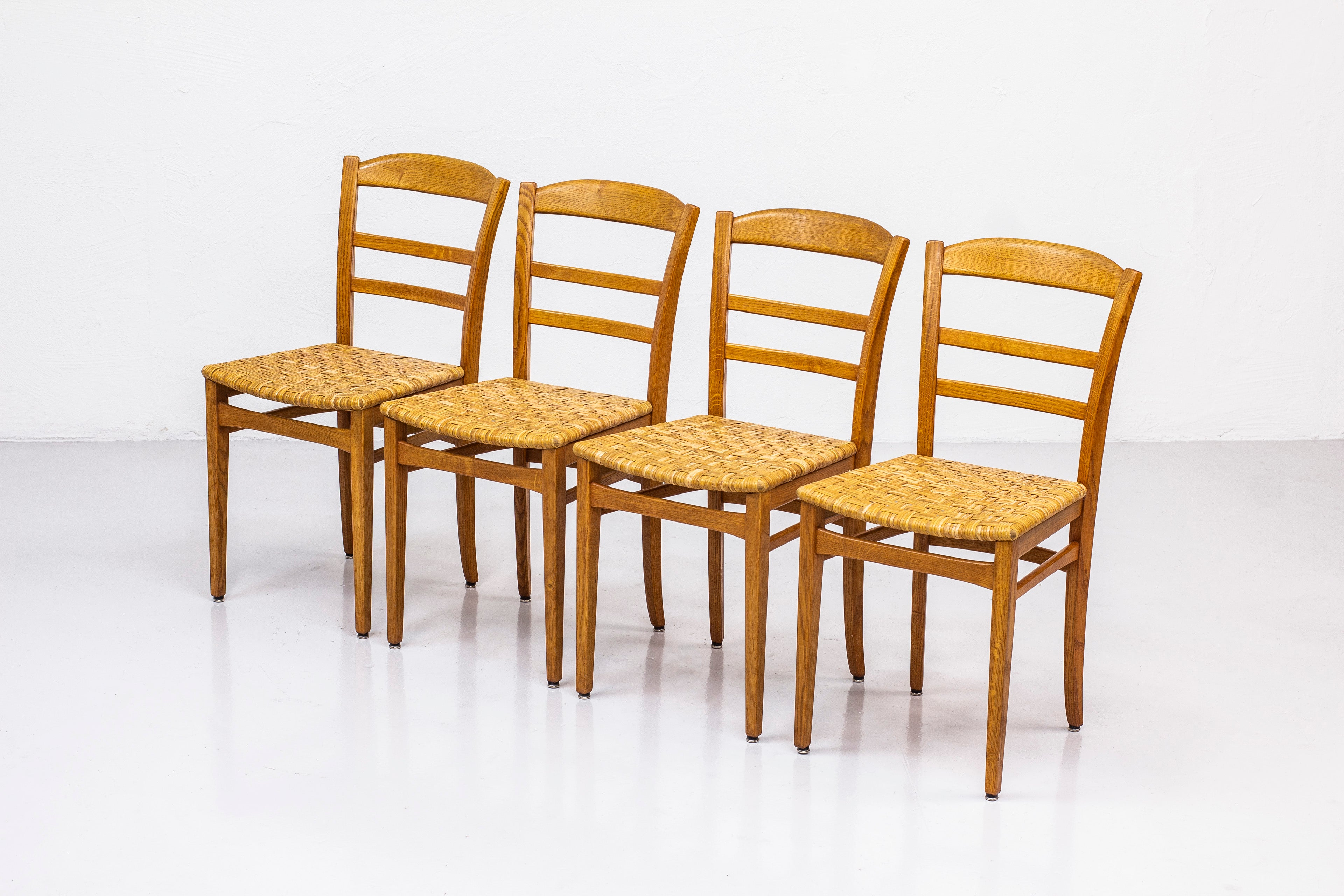 Dining chairs by Carl Malmsten