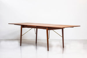 Dining table by Hvidt & Mølgaard