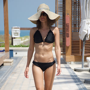 Black bikini with ruffles. Padded top and cheeky bottoms that are offer more coverage due to the ruffles.