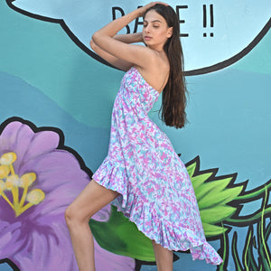 Wave Dress that is shorter in the front and longer in the back. Lilac blue colors that embrace every body.