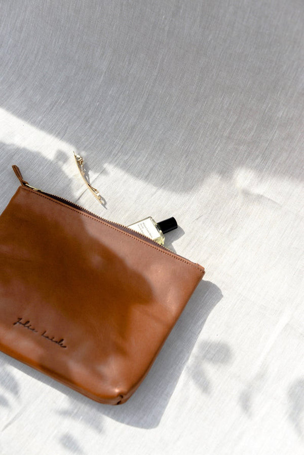 The Mojave Black Travel Clutch by Jolie Laide