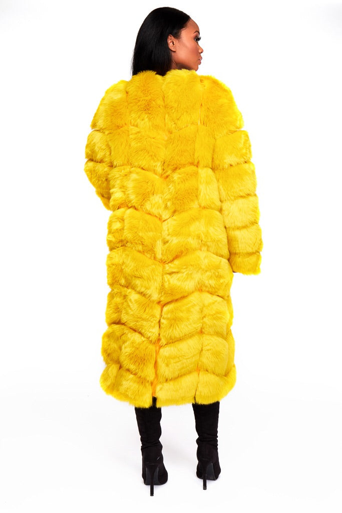 RIRI yellow faux fur coat