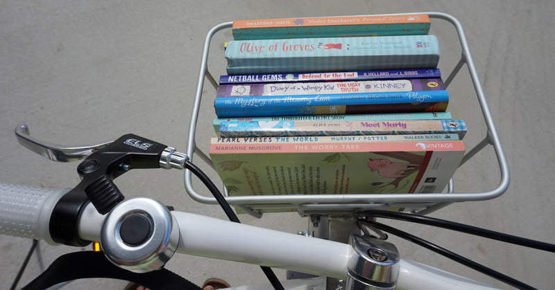 A kids bike with a basket to fit book!