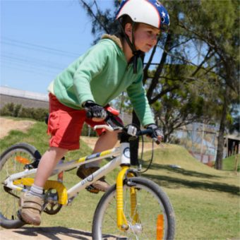 e-350-shelley-5-year-old-boy-riding-pump-track-sq400-web