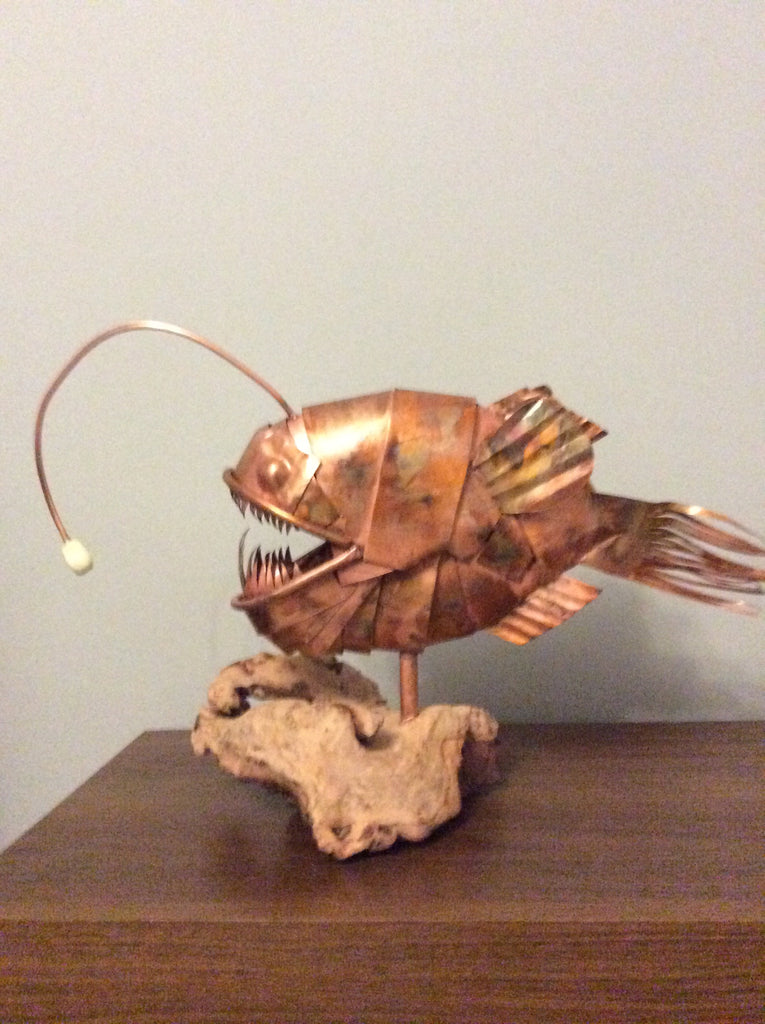 Copper anglerfish sculpture