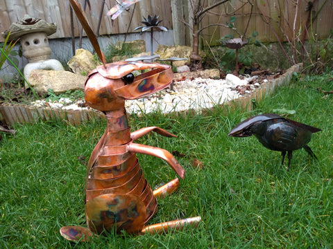 Copper hare and carrion crow sculpture