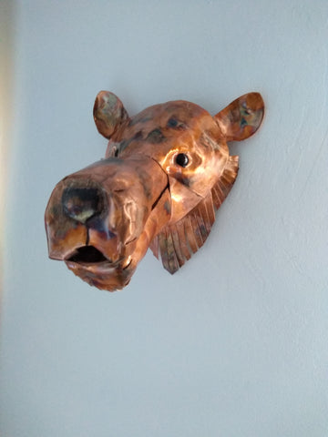 Copper bear head sculpture