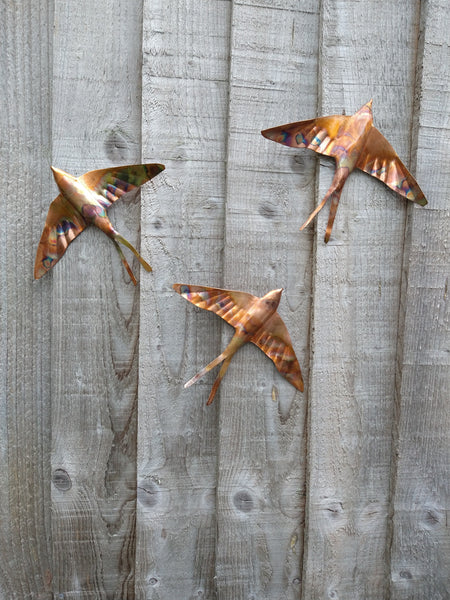 Copper swallow wall art