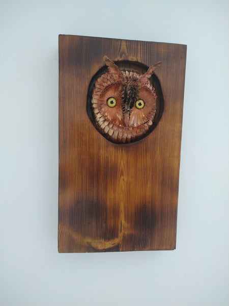 Long-eared owl copper sculpture