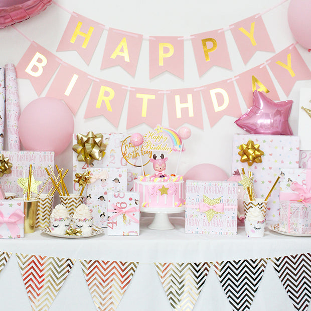 White and pink happy birthday theme wrapped gifts