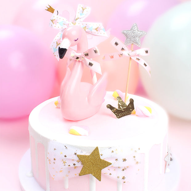 Pink Flamingo Cake Topper With A Ribbon