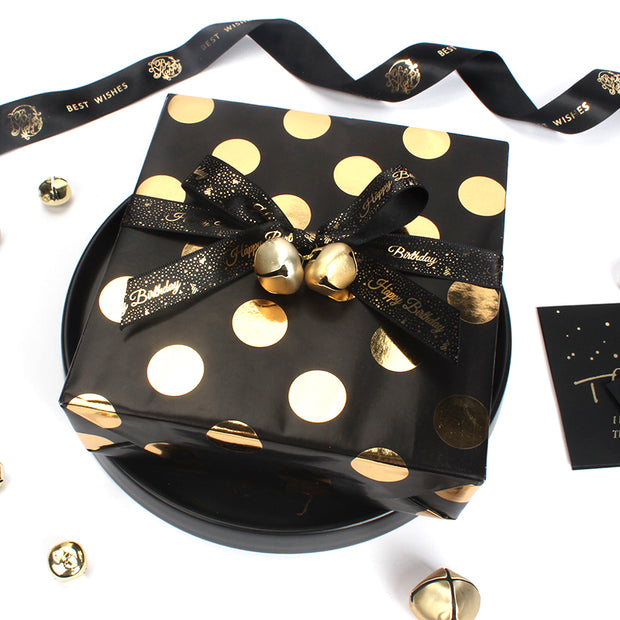 Black and gold polka dot metallic wrapped gift