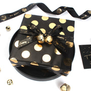 Black and gold metallic polka dot wrapping paper