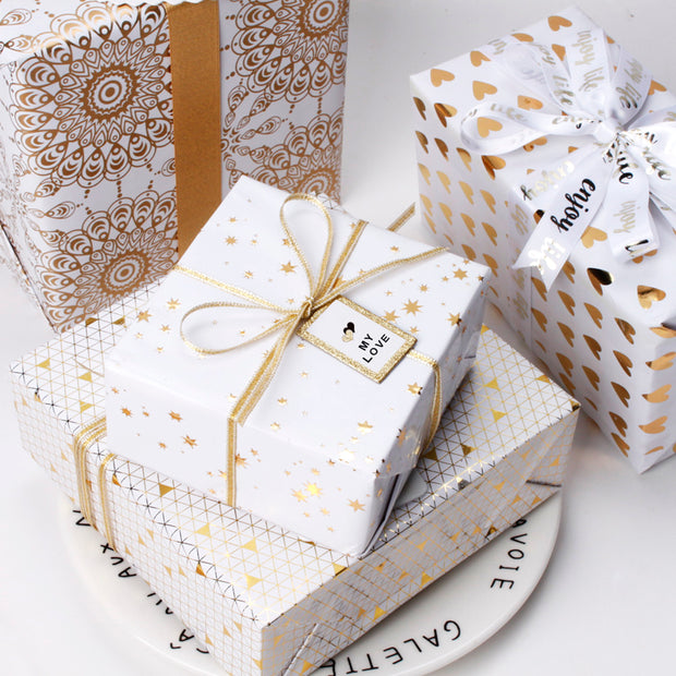 White and gold gift boxes wrapped with gift bows