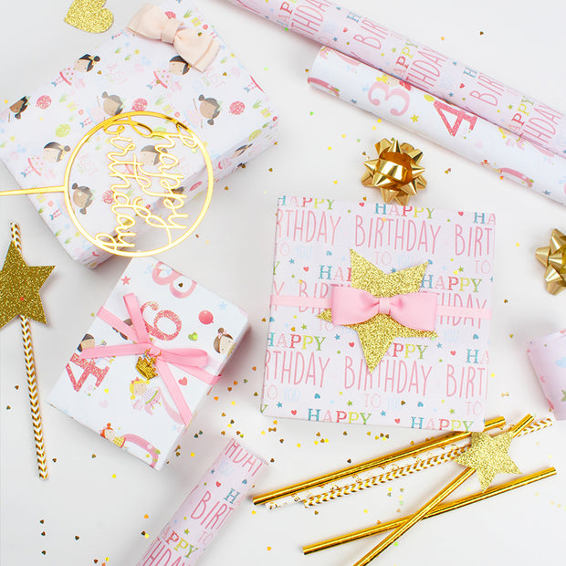 Pink and white happy birthday theme wrapped gifts