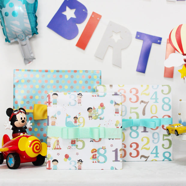 Teal and white birthday theme wrapping paper