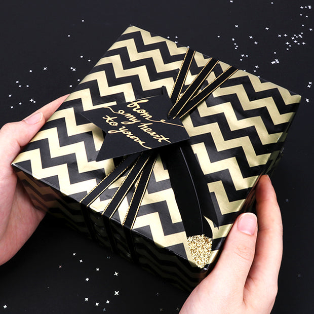 Black and gold chevron printed wrapped gift
