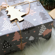 Dark grey wrapped gift with pink and black pine trees printed