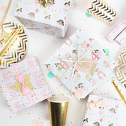 Pink and white birthday theme wrapped gifts