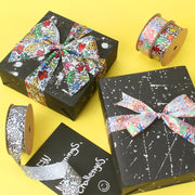 Black abstract graffiti gift boxes wrapped with ribbon
