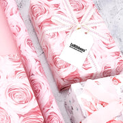Pink rose pattern printed wrapped gift with wrapping paper roll