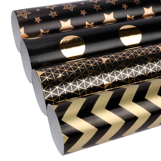 Black and gold metallic wrapping paper rolls