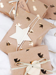 Gold foil Kraft wrapped gift packages