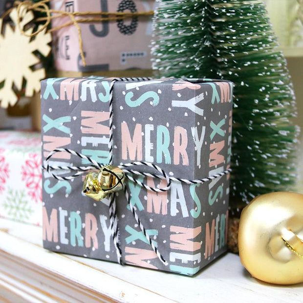 Grey, pink and teal gift wrapped box with black and white stripe ribbon