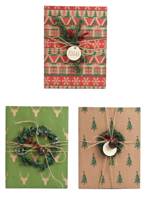 Green, red and beige Kraft gift wrapped boxes wrapped with twine ribbon