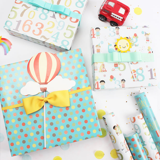 Teal polka dot happy birthday theme wrapped gifts
