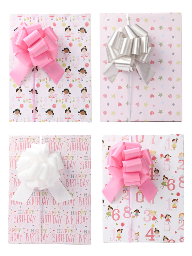 Gift boxes wrapped with pink white and silver gift bows