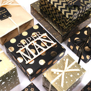 Gold and black metallic wrapped gift