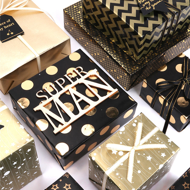 Gold and black metallic wrapped gifts