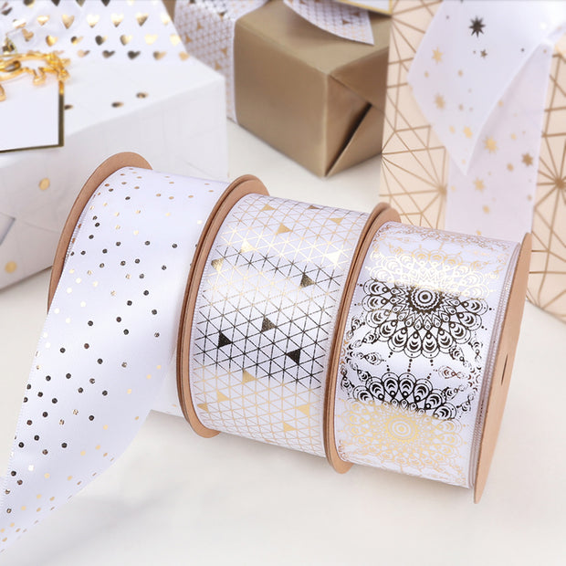 Three white and gold satin ribbons