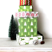 Stack of christmas novelty theme wrapped gifts