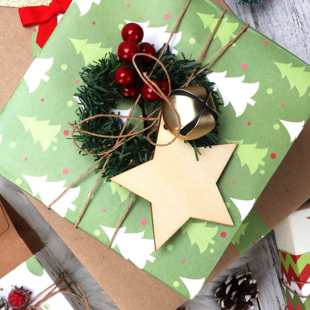 Green kraft pine tree wrapped gift with twine and a wood star gift tag