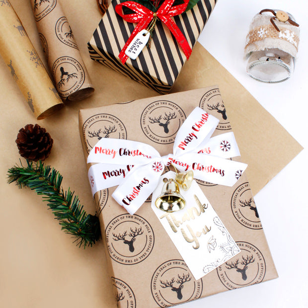 Reindeer Kraft wrapped gift with a white gift bow