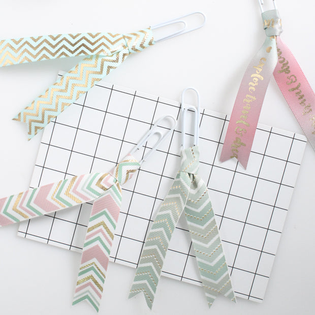 Collection of small, strips of green chevron metallic ribbons