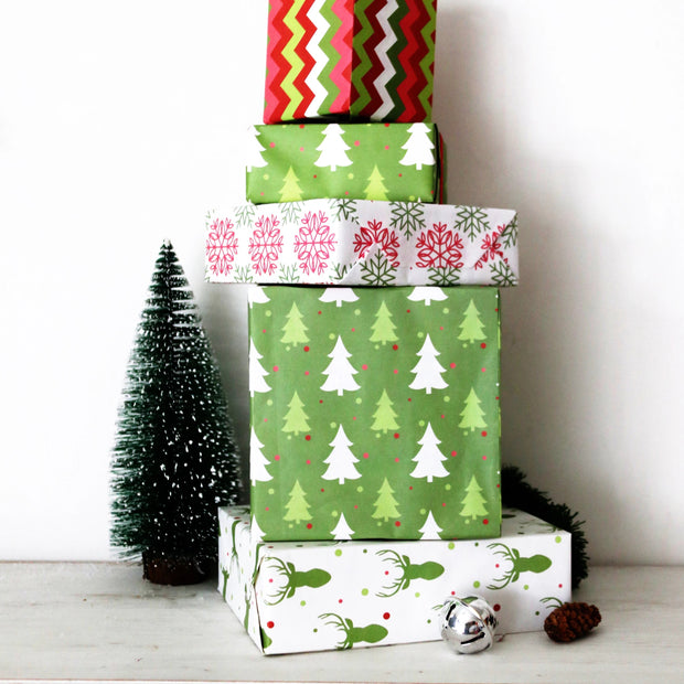 Stack of Christmas theme wrapped gifts on a mantle