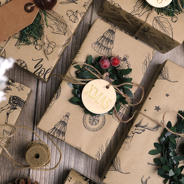 Beige kraft gift wrapped box with a round, wood gift tag