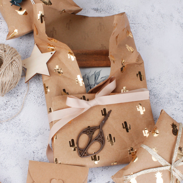 Brown kraft wrapping paper gift with a beige gift bow