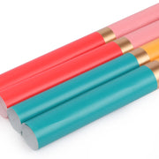 Four rolls of pink, yellow, beige and turquoise stripe wrapping paper