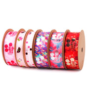 Collection of satin Birthday theme ribbon spools with gold printed designs