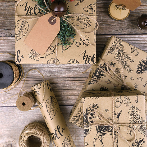 Collection of beige kraft gift wrapped boxes on a wood table