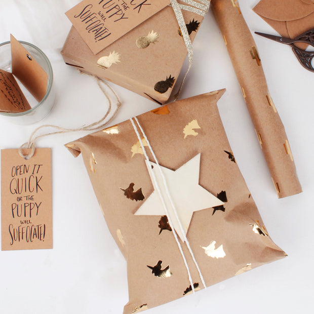 Brown kraft gold foil printed wrapped gifts