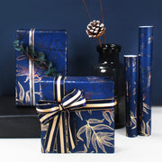 Dark blue and gold wrapping paper gift boxes, wrapped with gold ribbon